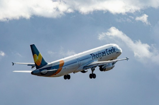 A Thomas Cook plane flying.