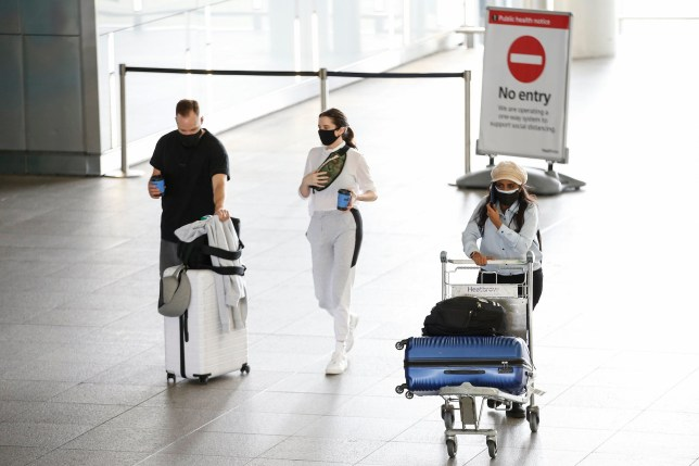 Travellers exit Heathrow Airport Terminal 2 on August 22, 2020 in London, England