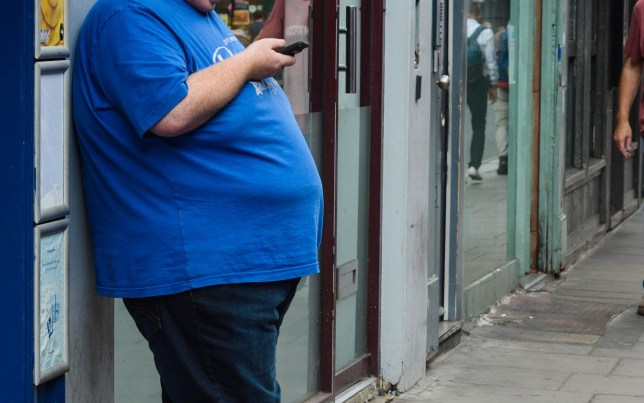 London, UK, August 6, 2019: Overweight man on street in Soho District ; Shutterstock ID 1472506682; Purchase Order: -