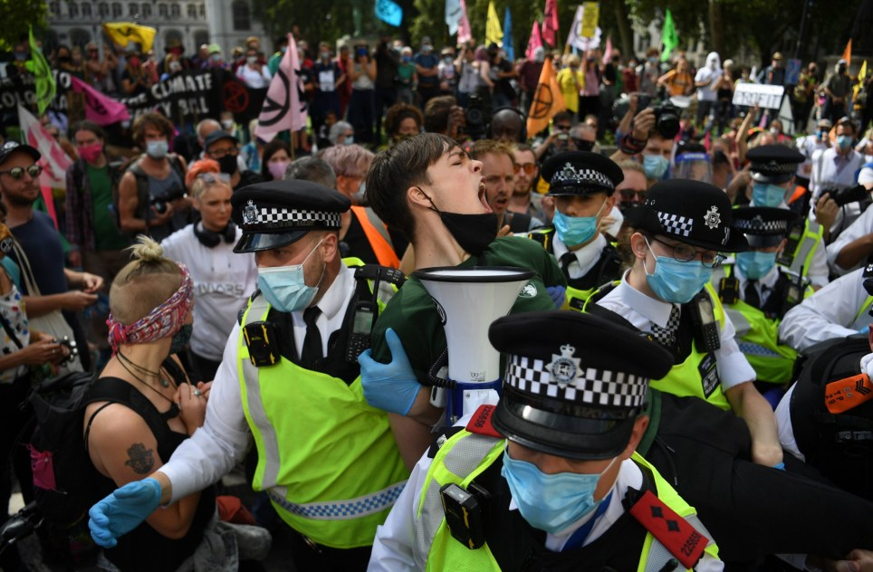Extinction Rebellion climate protesters arrested by police for blocking Parliament roads