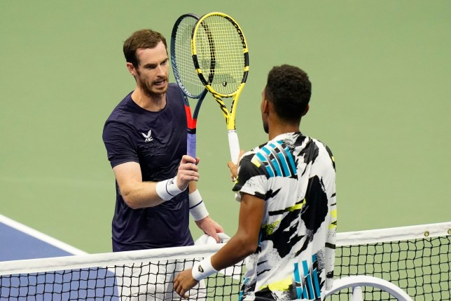 Felix Auger-Aliassime, of Canada, right, taps rackets with Andy Murray, of Great Britain, during the third round of the U.S. Open tennis championships, Thursday, Sept. 3, 2020, in New York. Auger-Aliassime won the match. (AP Photo/Frank Franklin II)
