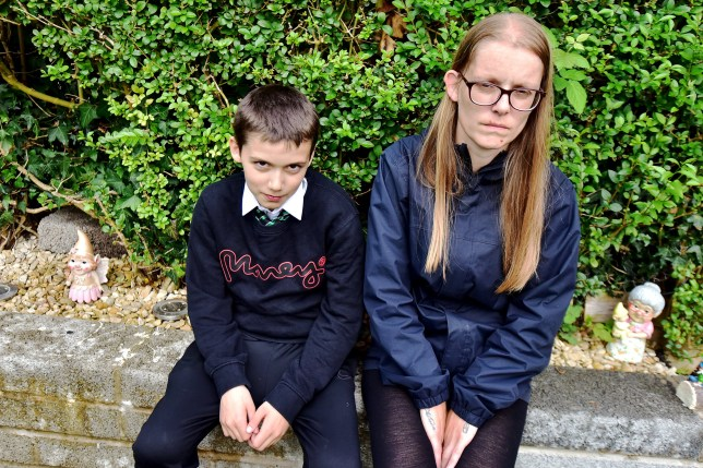 Hayley Dainton and son Oliver at home wearing the wrong uniform.