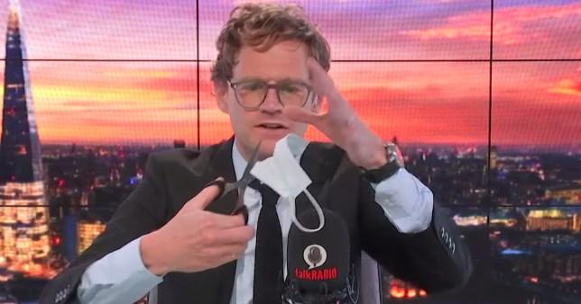 TalkRADIO's Mark Dolan cuts up face mask live on air
