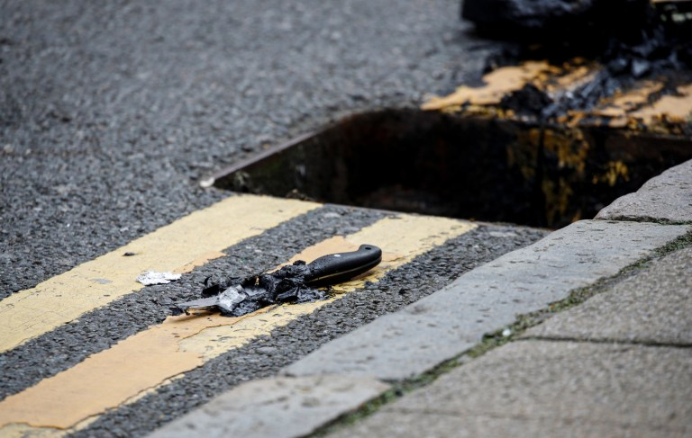 A knife lies on the pavement after being recovered by the police from a drain following reported stabbings in Birmingham, Britain, September 6, 2020. REUTERS/Phil Noble