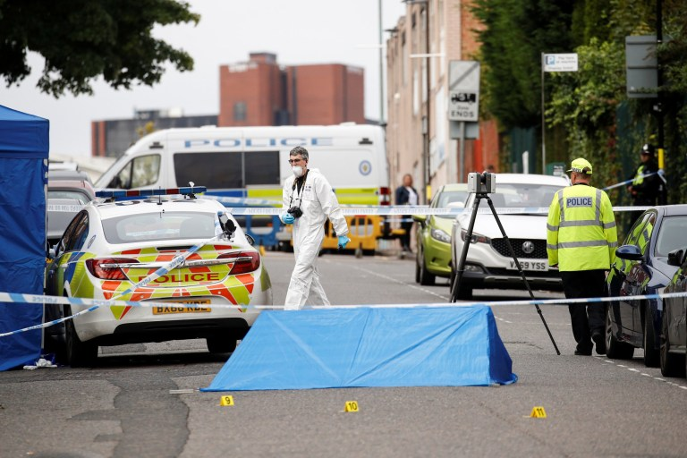 Police officers and a forensic worker are seen at the scene of reported stabbings in Birmingham, Britain, September 6, 2020. REUTERS/Phil Noble