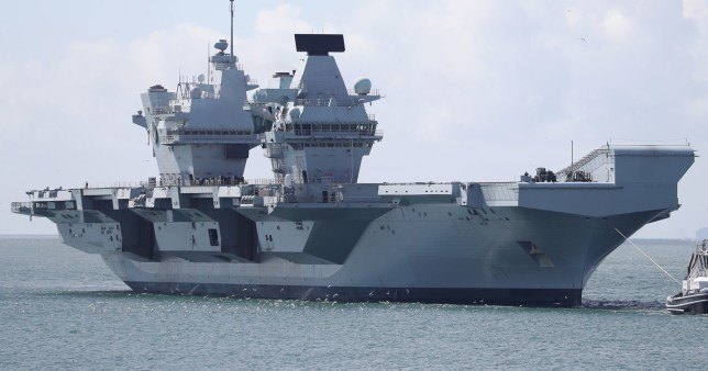 File photo dated 2/7/2020 of Royal Navy aircraft carrier HMS Queen Elizabeth which has postponed its sailing from Portsmouth Naval Base after a number of crew tested positive for Covid-19. PA Photo. Issue date: Monday September 7, 2020. The ?3 billion warship was set to leave Portsmouth Historic Dockyard on Monday afternoon for training exercises but the departure was put on hold at the last moment. See PA story DEFENCE Carrier. Photo credit should read: Andrew Matthews/PA Wire