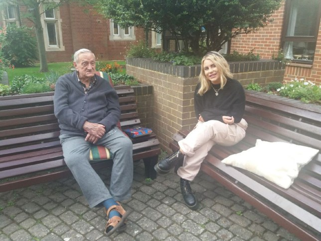 PIC BY CATERS NEWS (PICTURED Tayla visting her new 94-year-old bestie Ken) Despite their 70-year age gap, this pair are the best of friends after lockdown brought them together. 24-year-old Tayla Wright, from Upton, Northants, was furloughed from her hairdressing job in March and decided to volunteer at her local hospital for the next 12 weeks. Whilst volunteering at Northampton General Hospital, Tayla met 94-year-old Ken Smith, who was an inpatient recovering from a fall, and the pair hit it off straightaway. Tayla visited Ken, who couldn't have family see him due to Covid, most days and would spend hours helping him, chatting with him and aiding his recovery. SEE CTAERS COPY