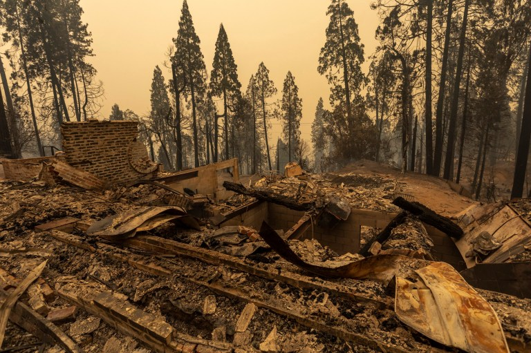 A community of forest homes lies in ruins along Auberry Road in the Meadow Lakes area after the Creek Fire swept through on September 8, 2020 near Shaver Lake, California.