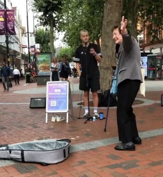 86-year-old woman dancing to busker's song