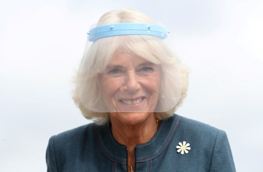 Camilla wears a face shield for the first time in public.