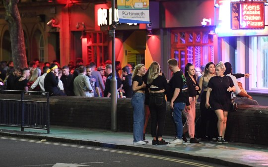 Hundreds of people enjoy a Friday night on the town in the pubs and bars in Guildhall Walk in Portsmouth, Hampshire