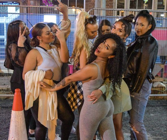 **Video with relevant desks** Pic by SnapperSK - (Pictured: Revellers pose for a photo on Birmingham's Broad Street as they enjoyed their night out before the 'rule of six' is brought in on Monday. Birmingham has also been hit with a local lockdown that comes into force on Tuesday [15th] due to a spike in Coronavirus. Pic Taken 11/09/2020) - Revellers hit the streets in Birmingham to take advantage of the last few evenings they are able to socialise in groups bigger than 6 ahead of Monday???s law change. Nightclubs on the city???s infamous Broad Street reopened on Friday evening after closing in March, 6-months ago due to coronavirus restrictions. Venues such as super-club Rosies and Pop World took bookings for party-goers to reserve tables as dancing is banned. Rosies offered tables for 25 pounds and the deposit could then be spent on drinks on arrival. It was announced on Friday that Birmingham was to go into a local lockdown on Tuesday [15th] due to a spike in Covid cases. A ban on people visiting other households will be placed to help curb the virus spread. Ladies took advantage of a warm evening to wear skimpy outfits with lots of flesh on show. Many clubbers were in high spirits. A friend tumbled to the floor as her mates attempted to pull her back up. A woman also clutched onto a big glass of gin as they hovered outside a bar in the Brindley Place drinking area off Broad Street. ENDS