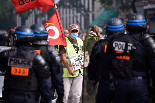epa08663769 French riot Police officers faceoff with Yellow Vests protesters during the 'act XCVI' demonstration of yellow vests movement in Paris, France, 12 September 2020. Yellow Vest protests are expected in several cities across France. EPA/JULIEN DE ROSA