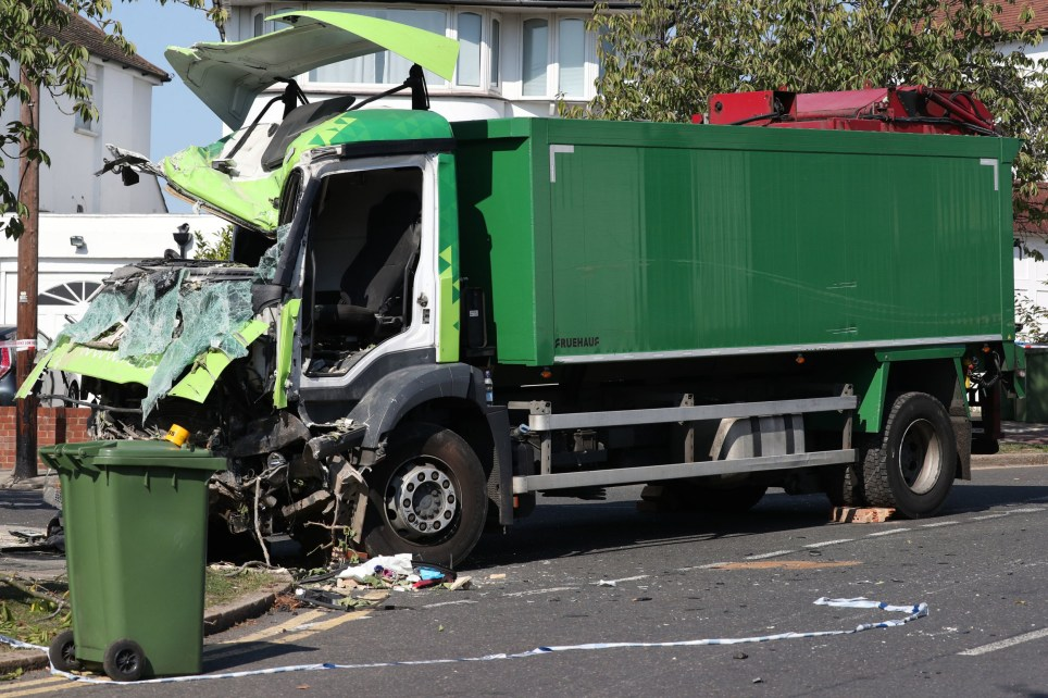 The scene of a collision in Broad Walk, Kidbrooke, south-east London, where the driver of a lorry which hit two cars before crashing into a house has died and an 11-year-old child is in a life-threatening condition in hospital. PA Photo. Picture date: Monday September 14, 2020. Two other males injured in the crash were also taken to hospital, with one of those later discharged. London Fire Brigade said the crash, involving a lorry and two cars, led to structural damage to a house in Woolacombe Road. See PA story POLICE Kidbrooke. Photo credit should read: Jonathan Brady/PA Wire