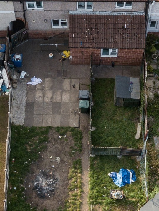 The house (centre) where a 12-day-old baby was mauled to death by a dog, Welfare Road, Doncaster. There is a dog pen in the rear garden of the property. September, 15 2020. Two people have been arrested after a 12-day-old baby died after being attacked by a dog in Doncaster.
