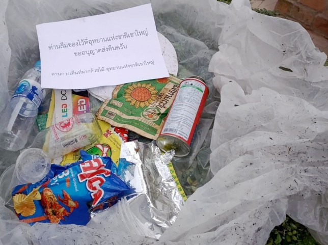 Thai Minister of Natural Resources and Environment Varawut Silpa-archa shows garbage left by tourists packed to be mailed back to them