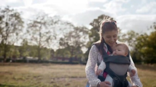 Screenshot of woman carrying her baby in This GIrl Can advert.