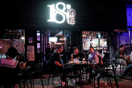 WUHAN, CHINA - SEPTEMBER 18: (CHINA OUT) People drink outside a beer bar on September 18, 2020 in Wuhan, Hubei province, China. As there have been no recorded cases of community transmission in Wuhan since May, life for residents is returning to normal. (Photo by Getty Images)
