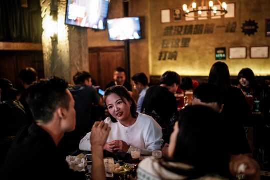 WUHAN, CHINA - SEPTEMBER 18: (CHINA OUT) People drink inside a beer bar on September 18, 2020 in Wuhan, Hubei province, China. As there have been no recorded cases of community transmission in Wuhan since May, life for residents is returning to normal. (Photo by Getty Images)