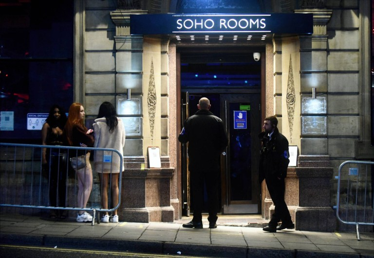 People are queuing outside of the Soho Rooms.