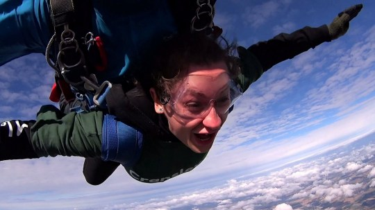 This is the thrilling moment a boyfriend took the plunge and proposed to his girlfriend while they skydived from 13,000ft.