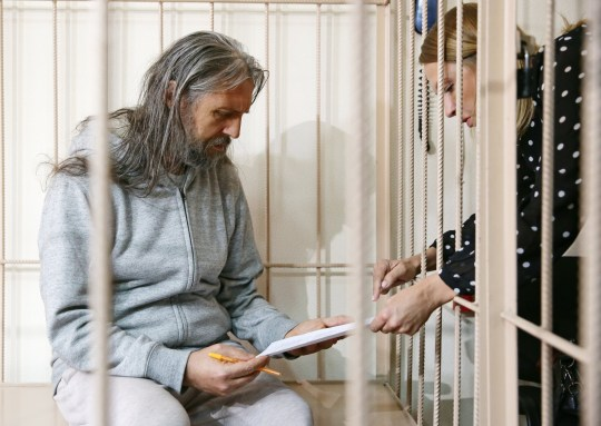 Sergei Torop speaks to a lawyer at Central District Court