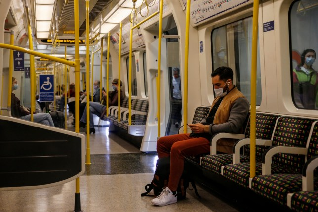 commuters on the hammersmith line in london