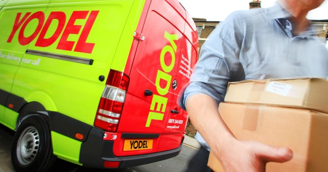 Mandatory Credit: Photo by John Alex Maguire/REX (5356164b)Yodel van and driver making a parcel deliveryYodel delivery van, London, Britain - 19 May 2010