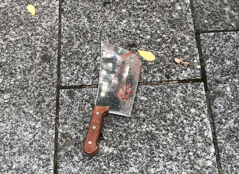 A meat cleaver that was use in a knife attack is left on the ground in Paris, Friday, Sept. 25, 2020. French terrorism authorities are investigating the knife attack that wounded at least two people Friday near the former offices of the satirical newspaper Charlie Hebdo in Paris, authorities said. A suspect has been arrested. (David Cohen via AP)