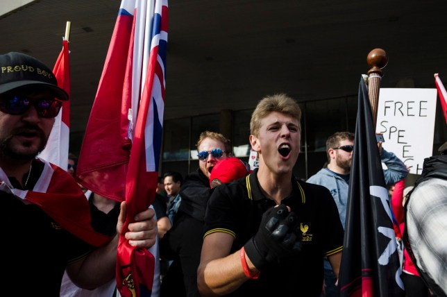 Members of the Proud Boys shout at a group of counter-protestors at Nathan Philips Square in Toronto on Saturday, October 21, 2017. THE CANADIAN PRESS/Christopher Katsarov