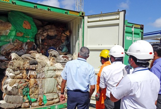 In this handout picture provided by Sri Lankan Customs on July 23, 2019, customs officials inspect the load of a container at a port in Colombo. - Sri Lanka customs on July 23 ordered the return of container loads of hazardous mortuary and clinical waste illegally imported into the island from Britain. (Photo by Handout / Sri Lankan Customs / AFP)HANDOUT/AFP/Getty Images