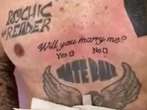 Man proposes to his girlfriend with a tattoo including 'Yes/No' tick boxes