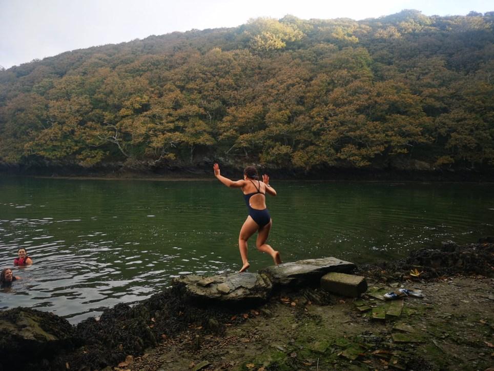 miranda larbi jumping into the river at thera-sea