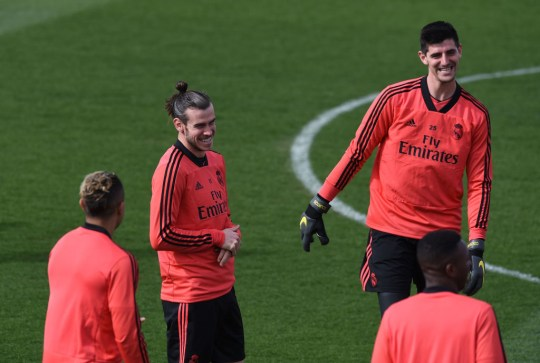 Gareth Bale of Real Madrid laughs with Thibaut Courtois during a team training session ahead the UEFA Champions League Round of 16 Second Leg match of the UEFA Champions League between Real Madrid and Ajax at Valdebebas training ground on March 04, 2019 in Madrid, Spain.