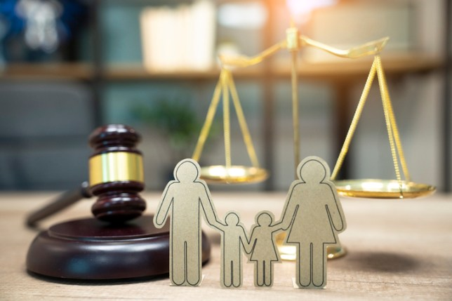 Family figure and gavel on table. Family law concept