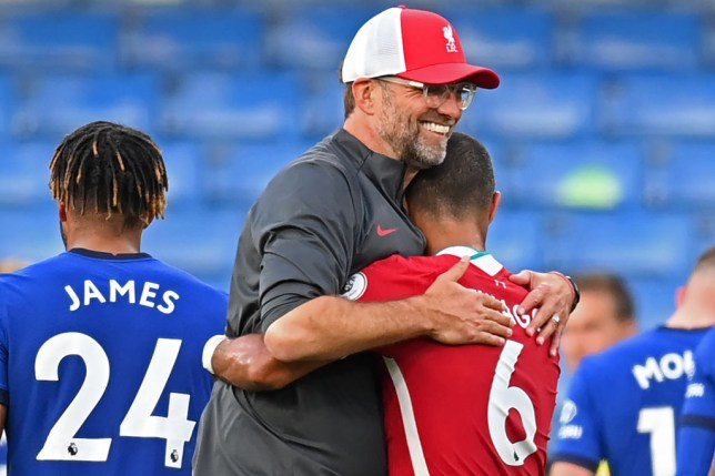 Liverpool's German manager Jurgen Klopp (L) celebrates with Liverpool's Spanish midfielder Thiago Alcantara on the pitch after the English Premier League football match between Chelsea and Liverpool at Stamford Bridge in London on September 20, 2020. - Liverpool won the game 2-0.