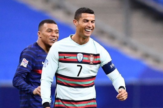 Kylian Mbappe and Cristiano Ronaldo share a joke after France's Nations League clash with Portugal