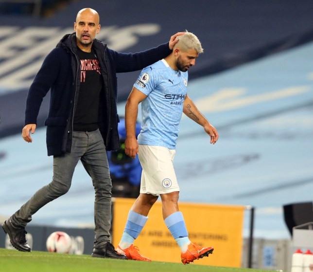 Manchester City's Argentinian striker Sergio Aguero (R) is substituted by Manchester City's Spanish manager Pep Guardiola during the English Premier League football match between Manchester City and Arsenal at the Etihad Stadium in Manchester, north west England, on October 17, 2020. (Photo by Alex Livesey / POOL / AFP) / RESTRICTED TO EDITORIAL USE. No use with unauthorized audio, video, data, fixture lists, club/league logos or 'live' services. Online in-match use limited to 120 images. An additional 40 images may be used in extra time. No video emulation. Social media in-match use limited to 120 images. An additional 40 images may be used in extra time. No use in betting publications, games or single club/league/player publications.