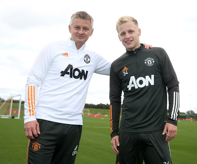 Donny van de Beek of Manchester United poses with Manager Ole Gunnar Solskjaer after a first team training session at Aon Training Complex on September 09, 2020 in Manchester, England.