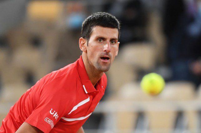 Novak Djokovic of Serbia looks at the ball after playing a shot during his Men's Singles Final against Rafael Nadal of Spain on day fifteen of the 2020 French Open at Roland Garros on October 11, 2020 in Paris, France.