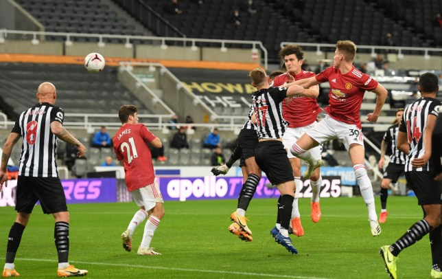 Harry Maguire heads home Manchester United's opening goal against Newcastle in the Premier League