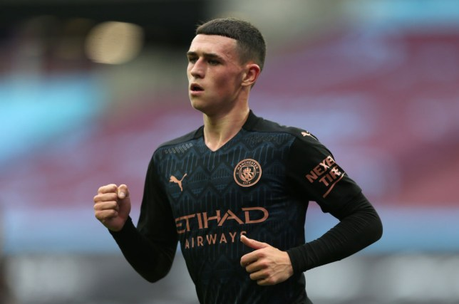 Phil Foden celebrates scoring for Manchester City in the Premier League against West Ham