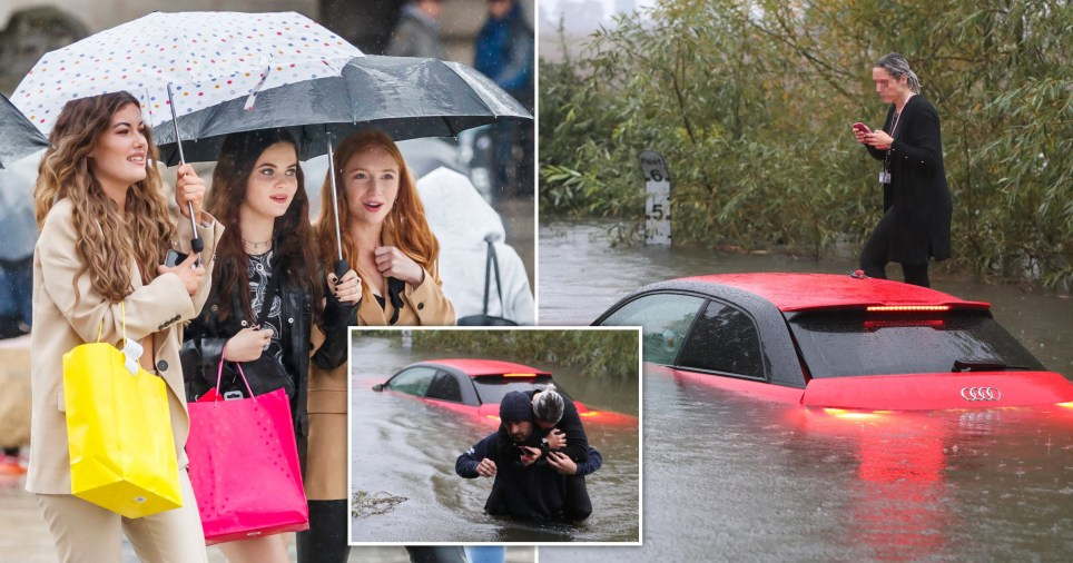 A woman is pictured being rescued from her car as heavy rain battered the UK due to Storm Alex