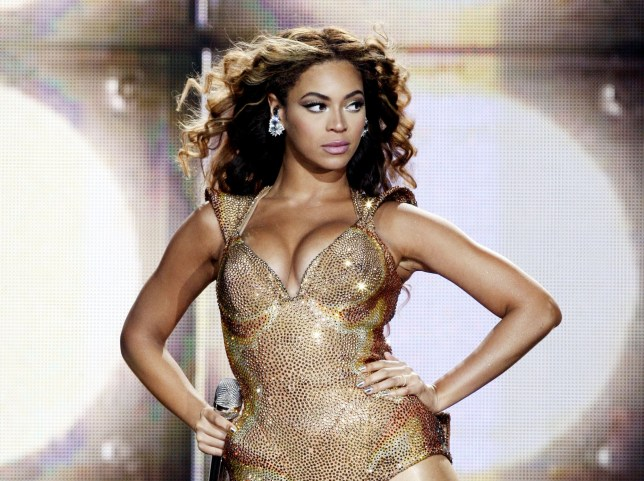 Beyonce performing on stage in gold bodysuit