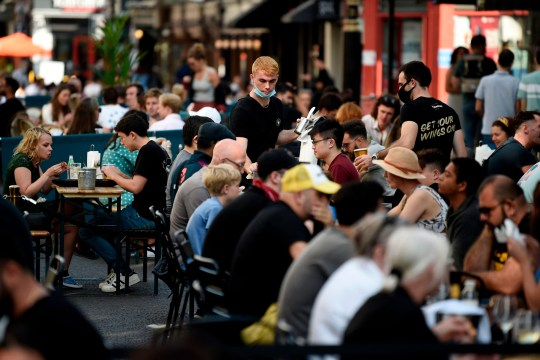 Customers eat sunday lunches at tables outside restaurants in Soho, in London on September 20, 2020 as the British government consider fresh nationwide restrictions after an rise in cases of the novel coronavirus. - The government this week tightened restrictions on socialising because of a surge in coronavirus cases, and imposed local lockdowns across swathes of the country. (Photo by DANIEL LEAL-OLIVAS / AFP) (Photo by DANIEL LEAL-OLIVAS/AFP via Getty Images)