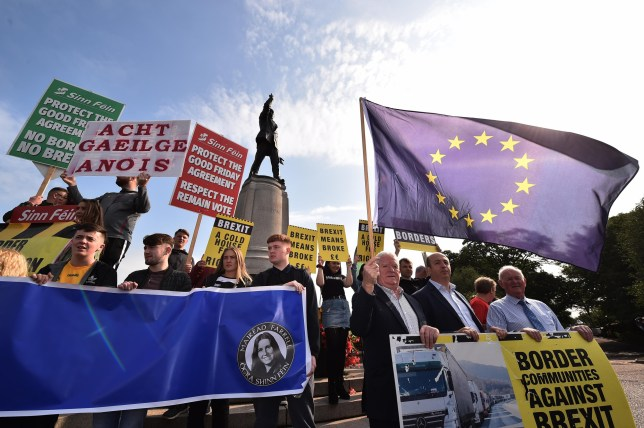 An Anti-Brexit protest takes place beneath the statue of Edward Carson as Prime Minister Boris Johnson visits Stormont on July 31, 2019 in Belfast, Northern Ireland.