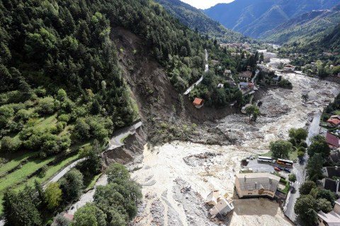 TOPSHOT - This aerial view taken on October 3, 2020 shows flood waters surging through Saint-Martin-Vesubie, southeastern France, after heavy rains and floodings hit the Alpes-Maritimes department. - Heavy rains and brutal floods have left villages cut off from the world in the Alpes Maritimes, where hundreds of fire-fighters have been mobilised on October 3, to find nine missing persons. (Photo by Valery HACHE / AFP) (Photo by VALERY HACHE/AFP via Getty Images)