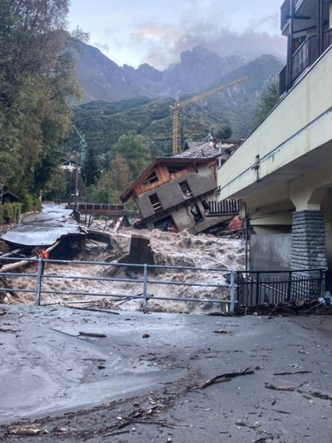 This photo taken on October 3, 2020 and provided by Italian news agency ANSA shows a three-storey building under renovation that collapsed next to a watercourse following bad weather and floods in Limone Piemonte, near Cuneo, Piedmont. - One person has died and 11 others are listed as missing on October 3, 2020 after severe flooding across northern Italy, officials said following torrential overnight rain. (Photo by STRINGER / ANSA / AFP) / Italy OUT (Photo by STRINGER/ANSA/AFP via Getty Images)