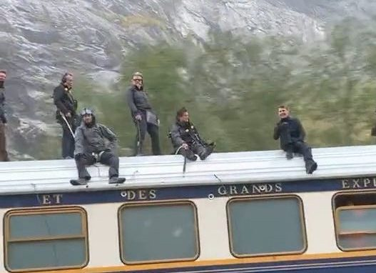 Tom Cruise films while on top of a train