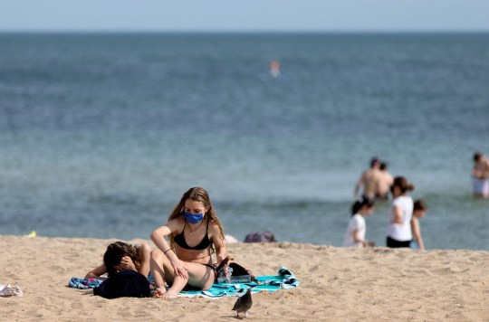 Beachgoers are seen sun baking during the COVID-19 Crisis. As Freedom protests are held across Melbourne in response to the governments COVID-19 restrictions, Melbournians flocked in their thousands to the beach as the temperature hit 26 degrees. Victoria recorded a further 21 new cases overnight along with 7 deaths.